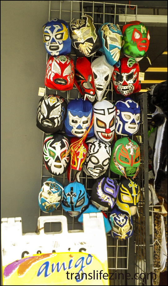 Luchador masks outside a store on Mission St., San Francisco, Ca.